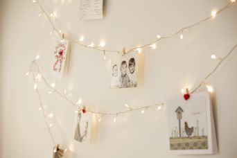 Indoor Fairy Lights as a photo display, too cute