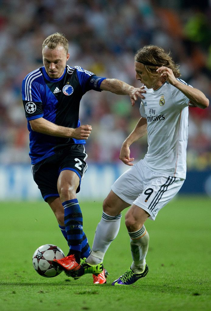 Lars Jacobsen of FC Copenhagen competes for the ball with Luka Modric of Real Madrid CF during the UEFA Champions League group B match between Real Madrid CF and FC Copenhagen at Estadio Santiago Bernabéu on October 2, 2013 in Madrid, Spain.