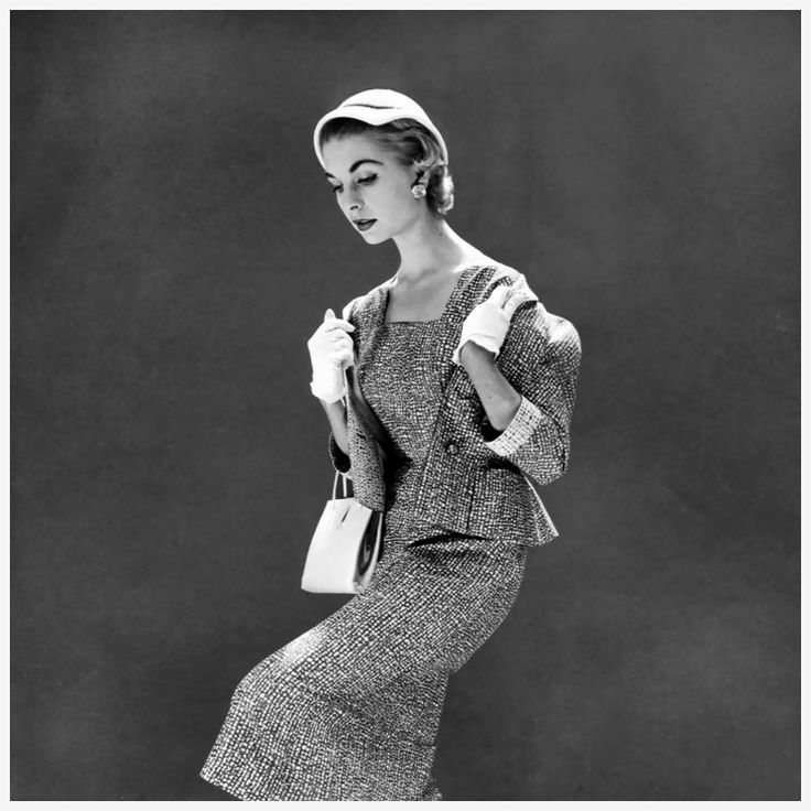 Suit by Jacqmar and cloche by Otto Lucas, photo by Norman Parkinson for British Vogue, April 1954