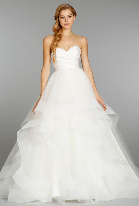 Hayley Paige . Ivory strapless natural waist bridal ball gown with silk radzmir crossover bodice, full tulle skirt with horsehair flounces and chapel train.