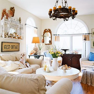 Love the mix of modern & cottage country touches with distressed furnishings...so eclectic, the chandelier has Olde World charm!