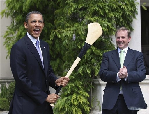 Why is Obama holding a hurling stick?