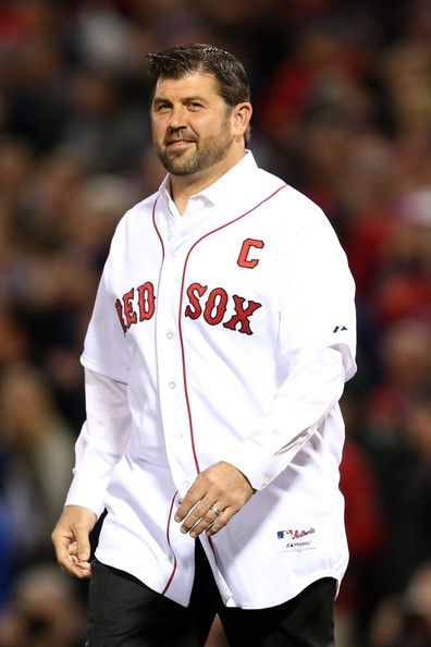 Former Boston Red Sox Jason Varitek takes the field before Game Two of the 2013 World Series between the Boston Red Sox and the St. Louis Cardinals at Fenway Park on 10.24.13. in Boston, MA.