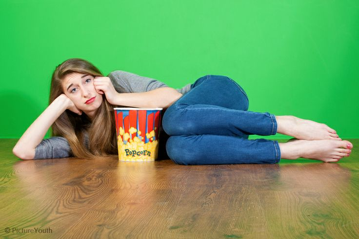 Teen girl watches a movie with popcorn.  #custom photography  PictureYouth.com
