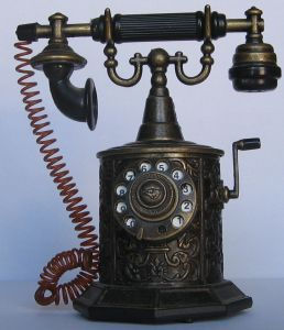 The first telephones were hand cranked and attached to the wall.  They had to be cranked to generate the electricity before it could be sent across the phone line by the switchboard.