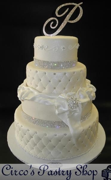Diamond Ivory Wedding Fondant Cake  Fondant Ivory Cake with Diamonds around and edible fondant bow with diamond brouche