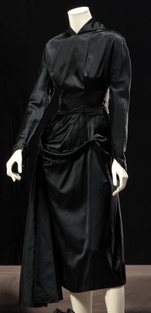 Jacques Fath   Haute couture, circa 19547-1950 dinner dress in black satin