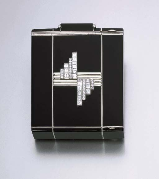 A RARE ART DECO DIAMOND AND ENAMEL VANITY CASE, BY OSTERTAG  The black enamel case, of square form and geometric design, decorated to the obverse with a central fluted and polished motif, extending graduated old European and rectangular-cut diamond vertical lines, the panel lifting to reveal a mirror and covered powder compartment, the black enameled reverse panel lifting to reveal an open compartment, further enhanced at the top terminal by diamond collet accents, circa 1930. Signed…