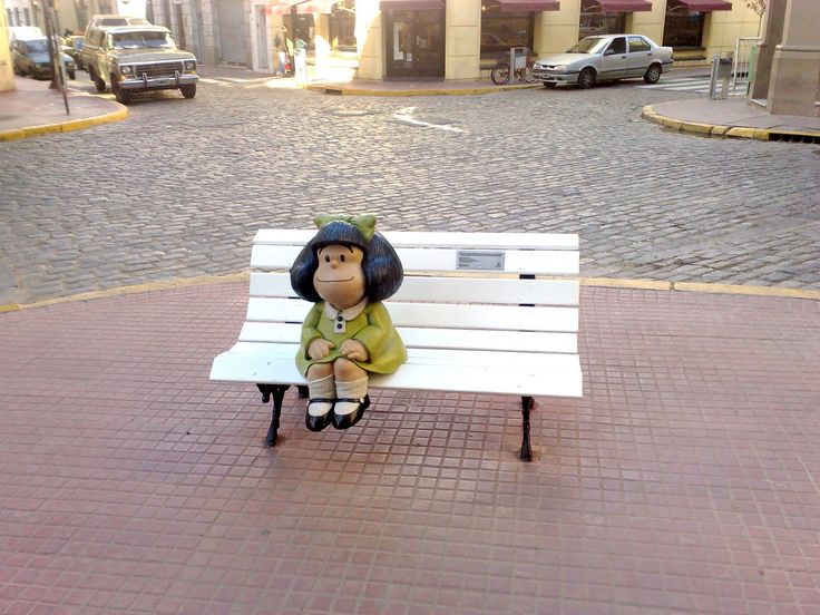 MAFALDA!!!!!!! Little girl at the suburbs Mafalda's monument at Buenos Aires, Argentina. She's the main character of a comic created by argentinian writer Quino, a humoristic and innocent view of society and politics in latinamerica.
