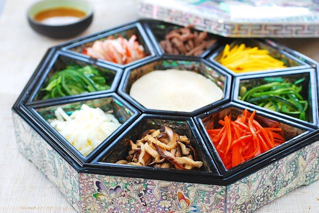 Gujeolpan is a beautiful and nutritionally well-balanced Korean traditional platter with 8 delicate fillings that are served with thin crepe-like pancakes.