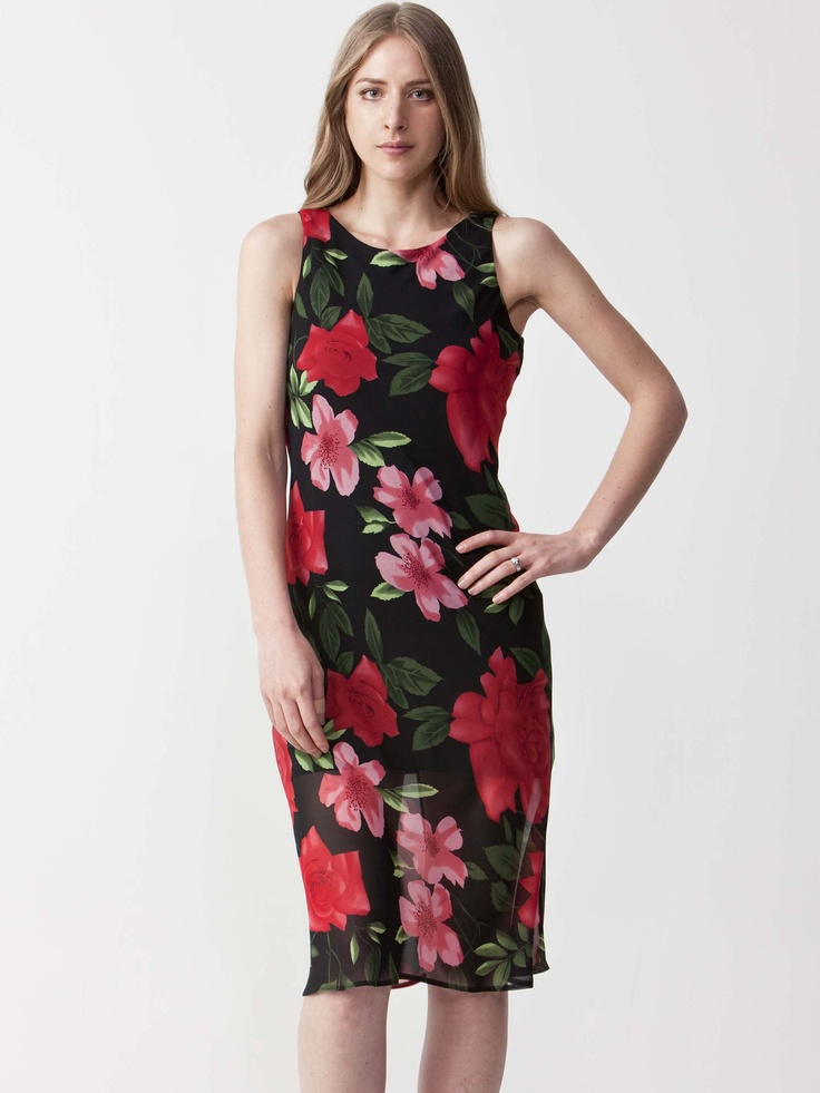 Tammi - Floral Print Midi Dress with round neckline. Sleeveless styling with rear circle cutout. Chiffon and pencil skirt. $77.00