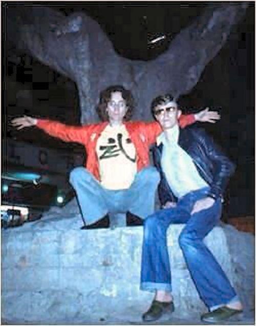 """John and David Bowie; Hong Kong 1977 - I wonder where this is? The shirt says """"Martial Arts"""""""
