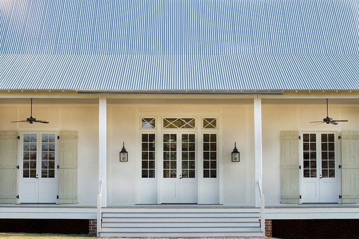 Country House — Bill Ingram Architect | French doors all around wrapped by full length operable shutters. BellaRusticaDesign.com BellaRusticaDesign.com