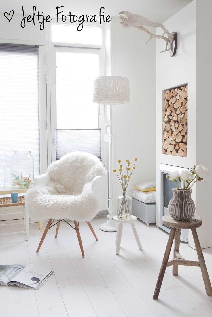 White and nature: Living room with bright colored accents. Photo by Jeltje photography