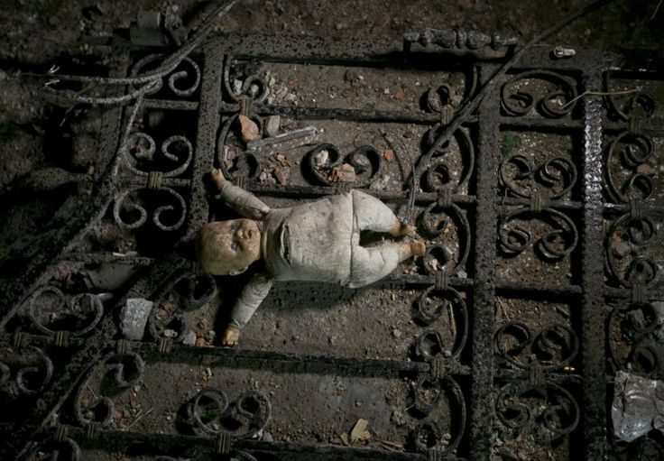 A doll lies in the rubble of a house in the area were a battle took place involving the police and an armed group, in northern Macedonian town of Kumanovo, on Sunday, May 10, 2015. Fighting between police forces and members of an armed group has ended after two days in the northern Macedonian town of Kumanovo leaving 8 police officers and 14 armed suspected terrorists dead. (AP Photo/Visar Kryeziu)