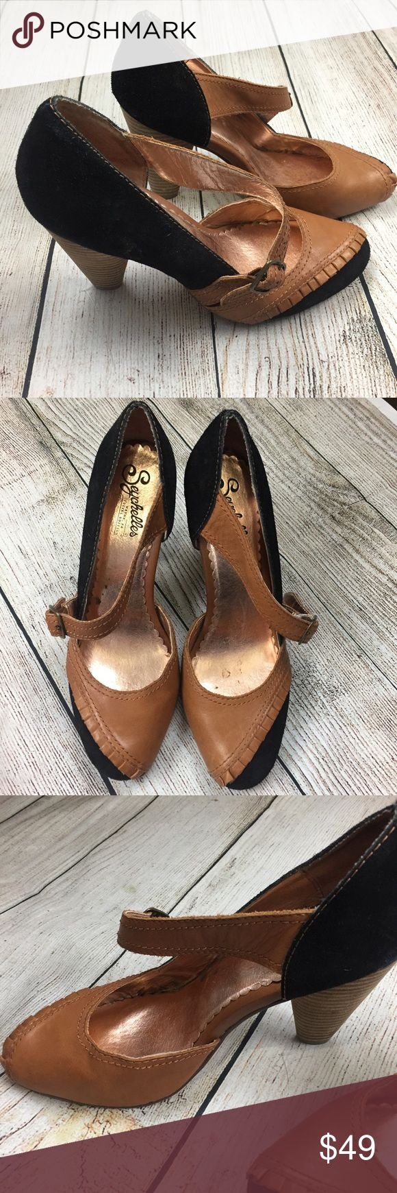 Anthropologie Seychelles two toned heels size 8 Anthropologie Seychelles special edition black and brown heels size 8...worn once or twice sticker still on bottom ...black suede with a camel color leather Ruffle and strap...absolutely vintage looking gorgeous! Anthropologie Shoes Heels