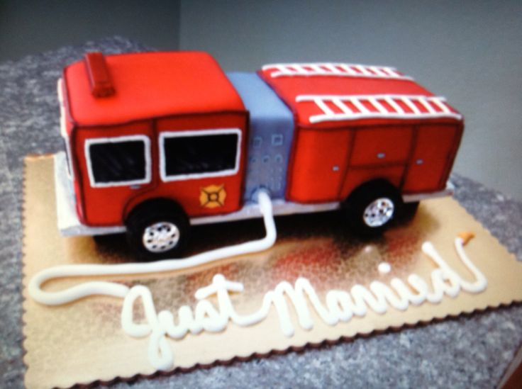"""This Firetruck is another example of a custom Groom's cake designed by our pastry chef. The Groom is an active duty Firefighter in the Army and he came home to get married. Our pastry chef added a special touch by writing """"Just Married"""" out of the fire truck hose."""