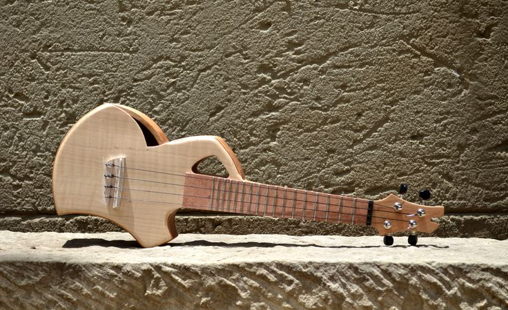 "A brand new design shape, ""newfangled"" soprano ukelele by murraykuun.com. Guitar and harp-guitar to follow in this shape."