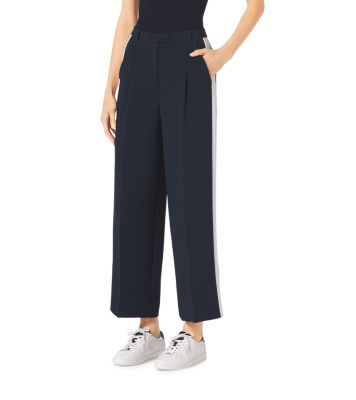 Tailored to perfection in a billowing wide-leg silhouette with a sleek tuxedo stripe, these pants are a luxe twist on menswear-inspired style. Crafted with a hint of stretch for a custom fit, this relaxed pair looks chic with a slim-fitting top and low-cut sneakers.