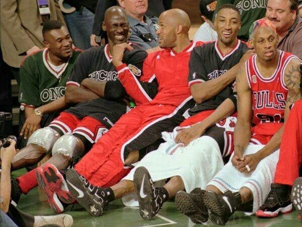 The GOAT, Ron Harper, Scottie Pippen, and Dennis Rodman resting after putting a game out of reach for the Bulls.