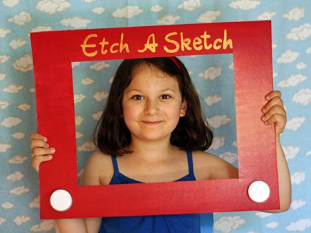 Daughter-in-law made a photo booth with cowboy hats and Toy Story signs and Etch a Sketch frame for Granddaughter's Toy Story party. FUN!!!
