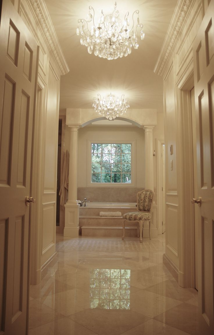 This bathroom is drool worthy features custom raised wall - Is marble tile good for bathroom ...