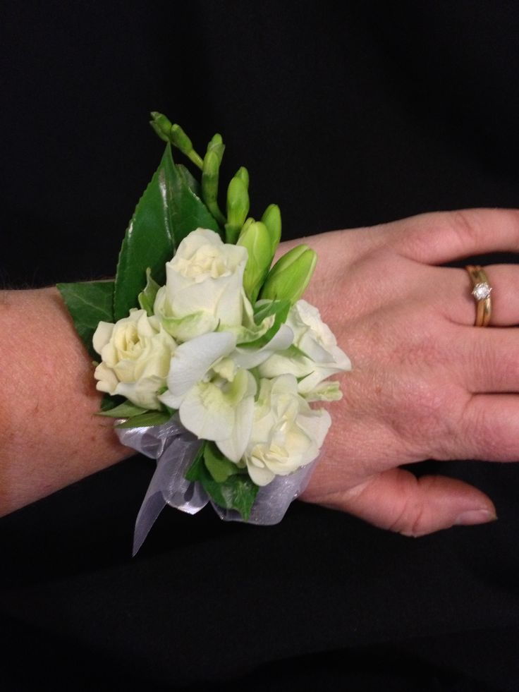 wrist corsage  roses and freesias