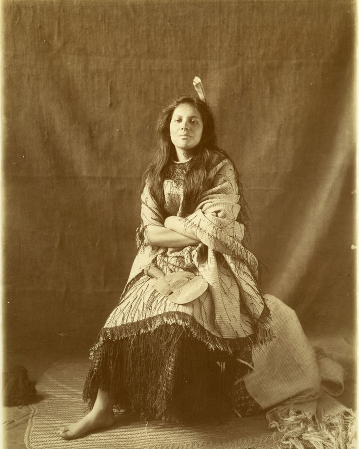 """""""This photograph titled Maggie Papakura is of Margaret seated in a staged studio. Her arms are folded defiantly, with her eyes directly challenging the photographer Edward Payton. Margaret's body language projects that she is tired of performing the submissive role of exotic maiden. She is resisting the commodification of people as objects that undermines identity and dignity, as encountered when guiding."""" - Coralie Takuira #Maori"""