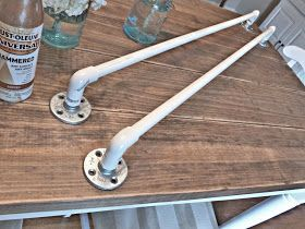 DIY:  How to Make Industrial Curtain Rods - That Look Like Copper  - using pvc pipe, a connector, a flange and copper spray paint, you can create your own rods for very little money - via Our Vintage Home Love