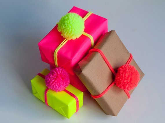 Lovely gift wrap idea, although not too keen on the colours. Love the pompoms though