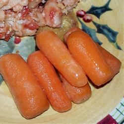 Terrible picture, amazing recipe.  Theis is my new go-to glazed carrot recipe! FROGHOPPER's Candied Ginger Carrots Allrecipes.com