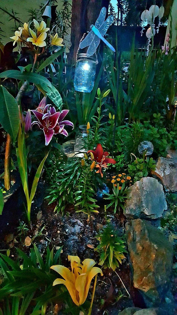 Garden at night.. mason jars blue glow peacefully..