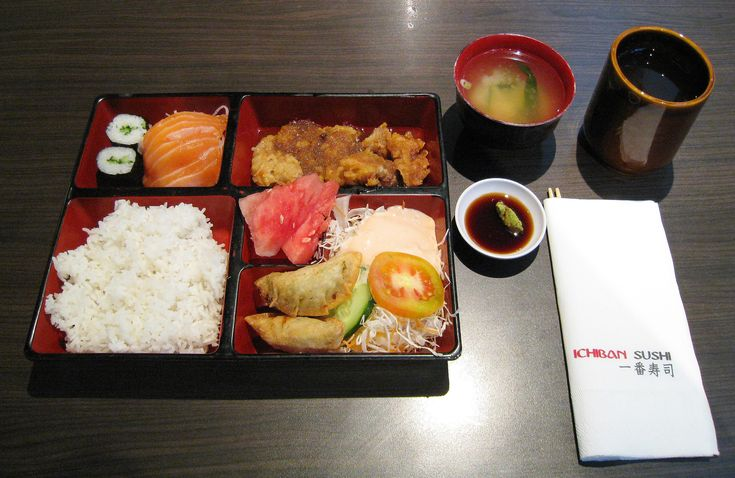 The Chicken Teriyaki Bento at Ichiban Sushi Restaurant, Jakarta, Indonesia. Consist of chicken teriyaki, rice, kyuri sushi, salmon sashimi, salad, gyoza, watermelon, miso soup, and green tea.