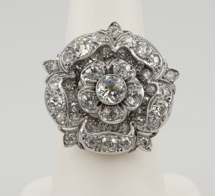 holy shit.  2 Carat Diamond Tudor Rose Ring | From a unique collection of vintage cocktail rings at http://www.1stdibs.com/jewelry/rings/cocktail-rings/