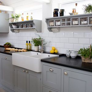 Shaker style kitchen, hand painted in grey with bespoke shelf system with glass jars