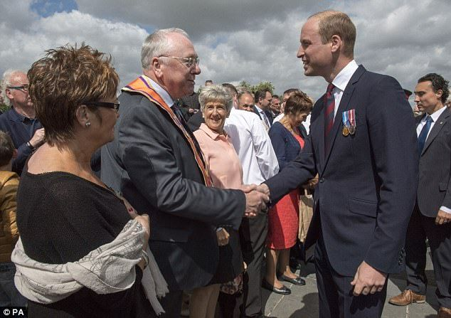 The Duke of Cambridge meets the Grand Secretary of the Orange Order Reverend Mervyn Gibon following a ceremony at the Island of Ireland Peace Park in Messines