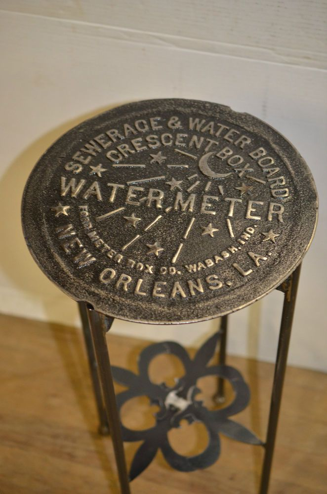 Up for sale is a CUSTOM made table using a GENUINE New Orleans Water Meter Cover. The legs are a solid steel(not tubular) and are complimented with Fleur de Lis braces for that great NOLA feel. NOLA Water Meter Cover Table. | eBay!