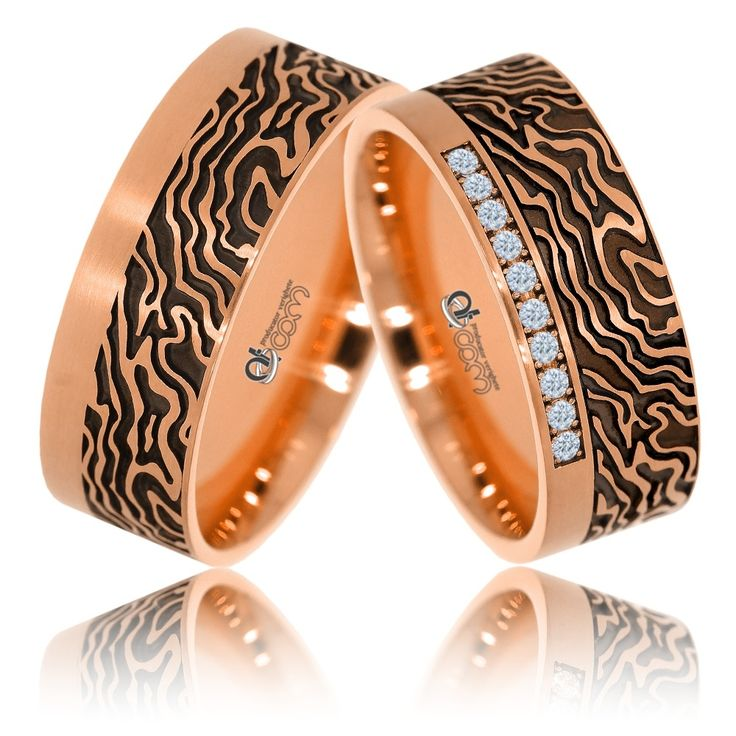 Verighete ATCOM lux AFRICA aur roz. Pe banda de nunta a damei sunt incrustate in setare canal 10 diamante / cristale de zirconiu.