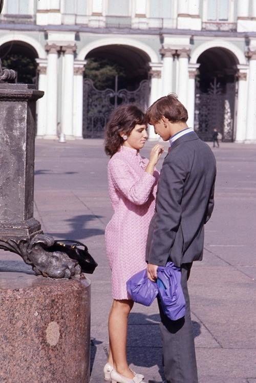 A village couple on Palace Square, Leningrad, 1965-67.