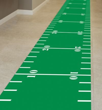 Guests will feel special when you roll out the green carpet at your football theme party! Football Field Floor runner fits in the hallway at your football party.