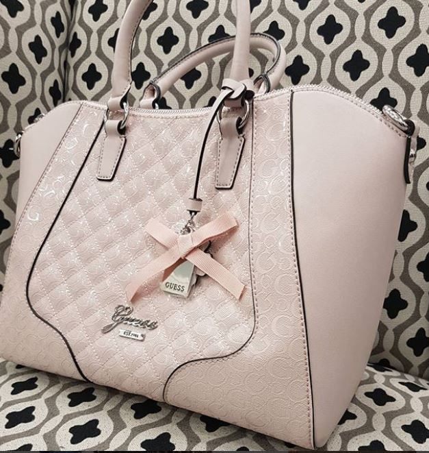 You.will be stepping out in style with this pretty pink #guess handbag for only 23.00 and we are always looking for more purses & wallets  #welovehandbags #platosclosetcambridge #gentlyused #shoplocal #cbridge #regionofwaterloo #thriftstorefinds | www.platosclosetcambridge.com
