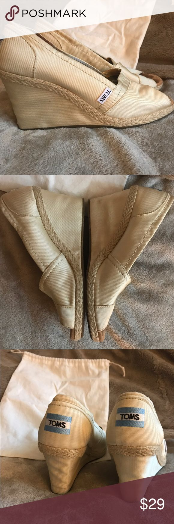 Toms Stella Peep Toe Wedges Size 8 Toms Stella Peep Toe Wedges Size 8. Satiny champagne colored fabric with braided details. These shoes are well loved but in very good condition! TOMS Shoes Wedges