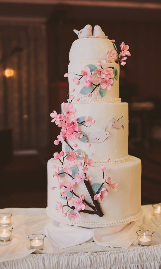 Chic three tier white wedding cake wrapped with mini pink flowers; Featured Photographer: Be Light Photography