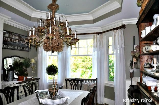 Love this dining room! I have a bay window like that and this just might be the color I need to paint my walls!