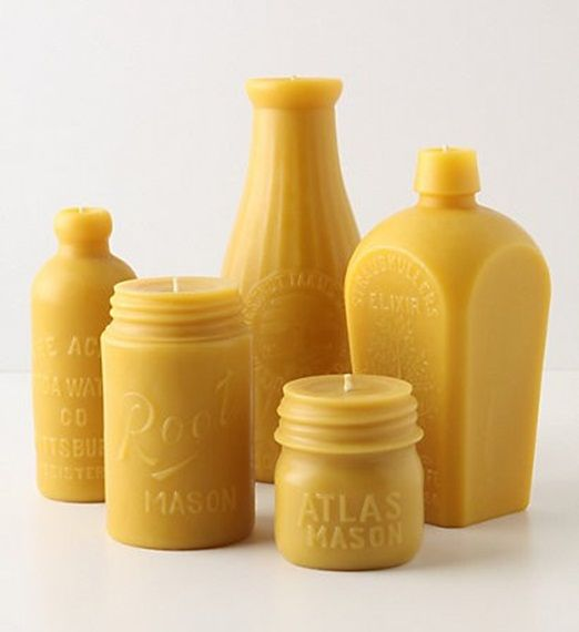 Vintage bottle shaped candles for your wedding table centrepieces | The Natural Wedding Company