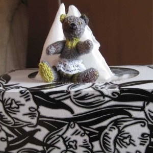 Lucille is a dainty little bear with a lace skirt. The tissue box is there to show how little she is.
