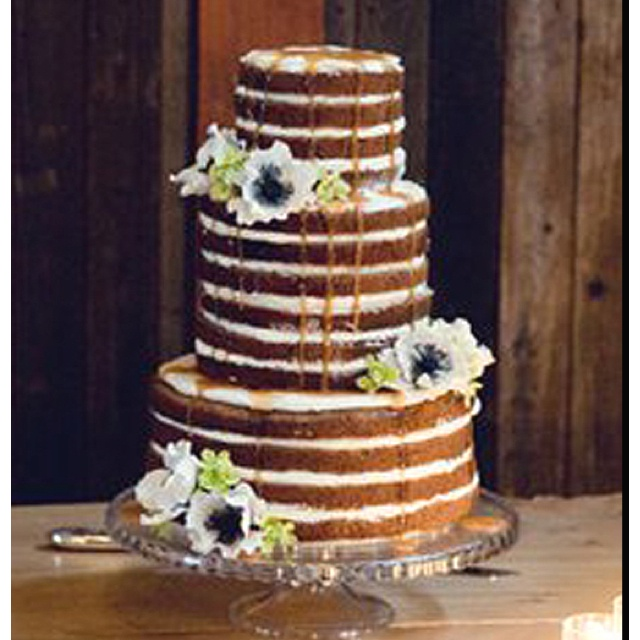 2 tier naked cake...but with blonde cake and some red flowers?