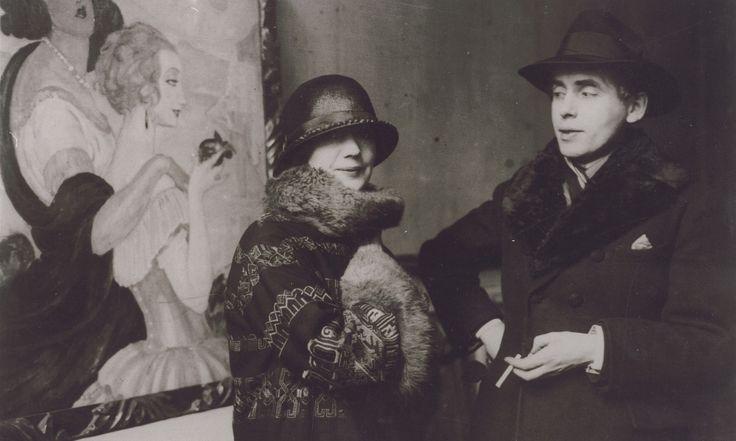 1924 Gerda and Einar Wegener in front of one of her paintings.