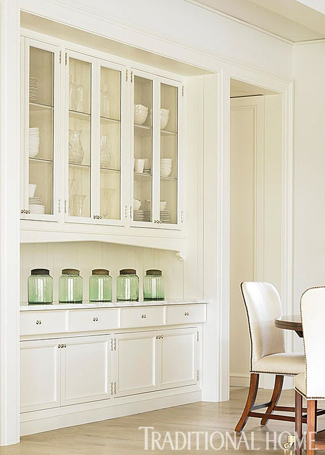 Custom White Cabinets Near The Breakfast Area Are Both Functional And With Addition Of Glass Cabinet Doors Aesthetically Pleasing