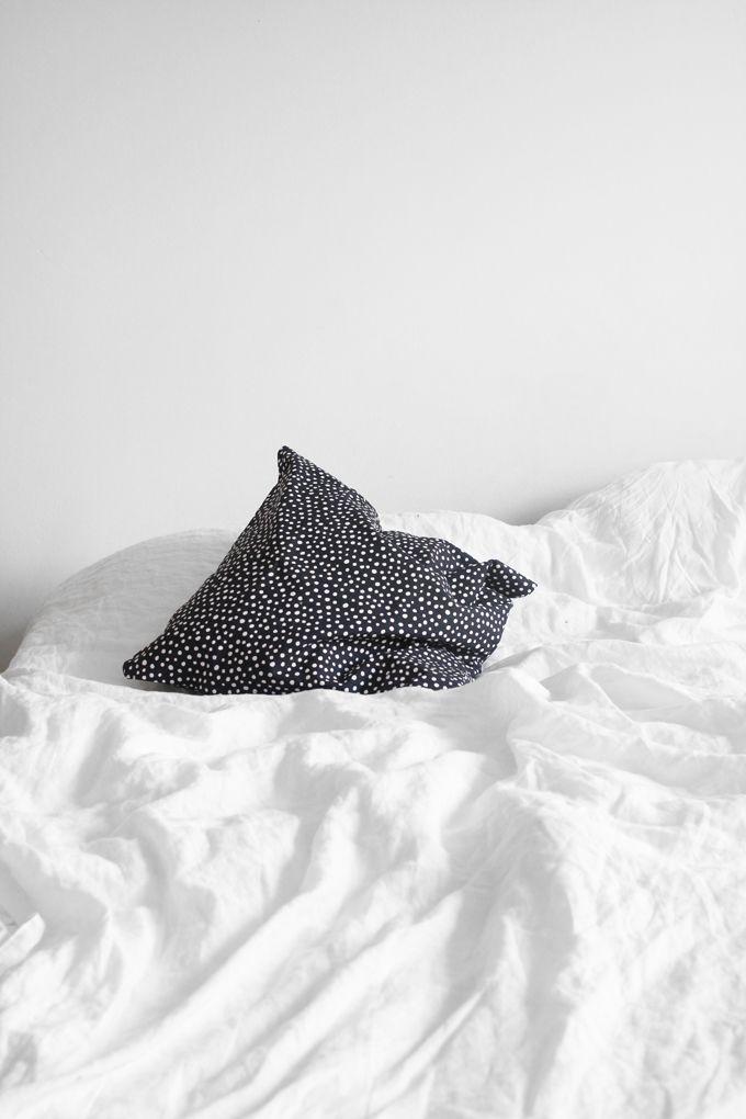 white sheets & print throw pillow #homedecor #bedroom #interiordesign